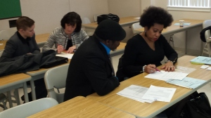Delaware DOL Pro Sherese Brewington-Carr helps a veteran with his resume. More than 200 people attended the HOH job fair Thursday January 22, 2015